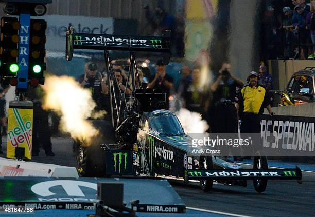 Top Fuel driver Brittany Force lights it up coming off the line and sets a new track record with a top speed of 323.74 mph on her first qualifying...