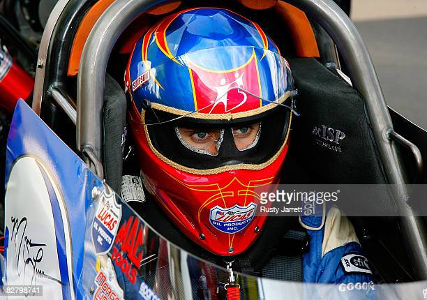 Top fuel driver Morgan Lucas sits in his car during qualifying for the NHRA Carolinas Nationals at the Zmax Dragway on September 12 2008 in Concord...