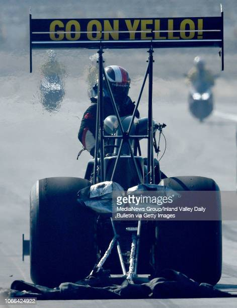 Top Fuel driver Steve Torrence climbs from his dragster during the first round of eliminations in Pomona on Sunday November 11 2018 at the 54th...