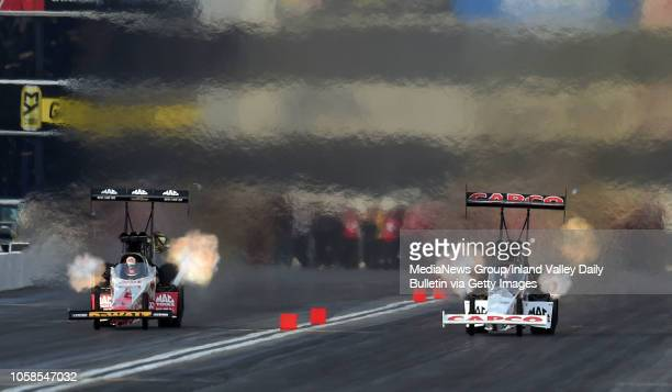Top Fuel drivers Doug Kalitta and Steve Torrence qualify against each other during the final round of qualifying at the 58th annual NHRA...