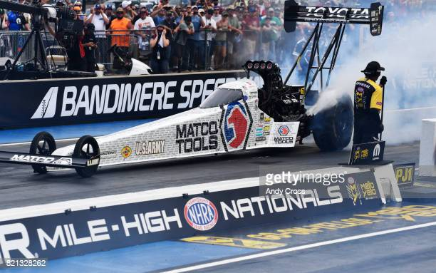 NHRA top fuel race car drover Antron Brown during his burnout before his victory at the38th annual NHRA Mopar Mile High Nationals at Bandimere...