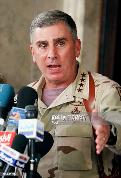 US top general in the region John Abizaid speaks to the press after a meeting with Iraqi President Jalal Talabani at the Presidential Office in the...