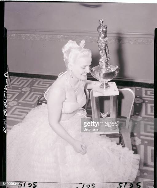 Elfriede Hartwich models the hairdo which won for her husband Richard Hartwich of Hamburg Germany the world's supreme styling championship for the...