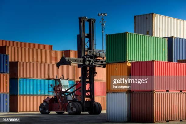 Top Handler Working in Shipping Terminal