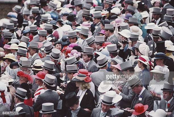 Top hat and tails and morning dress for the spectators in the enclosure for Royal Ascot on 20 June 1984 in Ascot, United Kingdom.