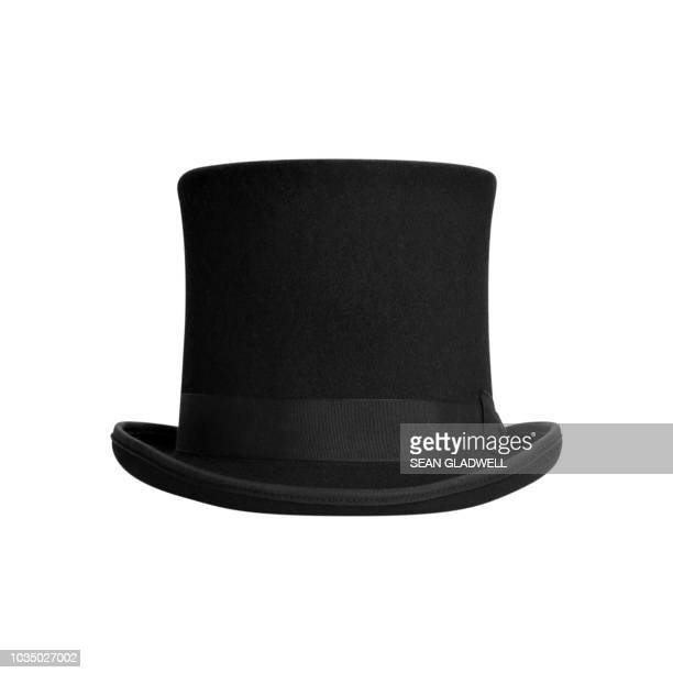 top hat on white background - hat stock pictures, royalty-free photos & images