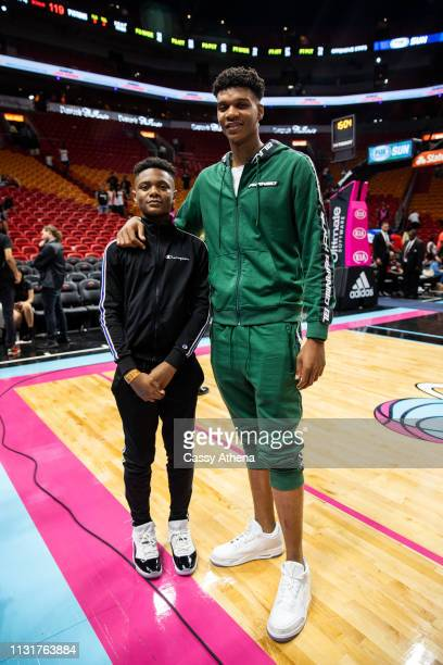 Top high school player Isaiah Todd and his brother pose after the Miami Heat vs Detroit Pistons game at American Airlines Arena on February 23 2019...