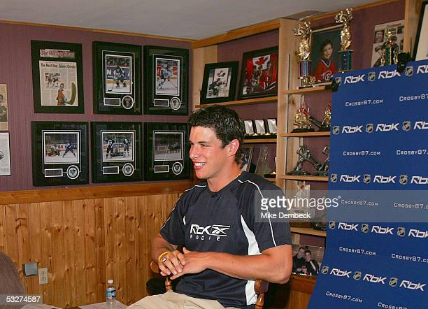Top hockey prospect Sidney Crosby prepares for an interview in the basement of his house after hearing the results of the NHL draft lottery on July...