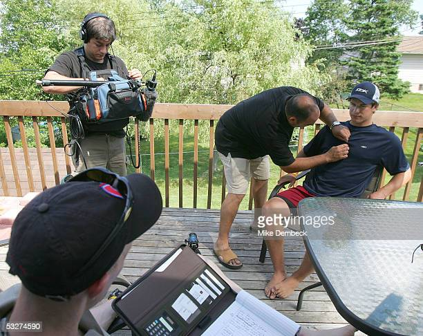 Top hockey prospect Sidney Crosby prepares for an interview on the back deck of his house while waiting for the results of the NHL draft lottery on...