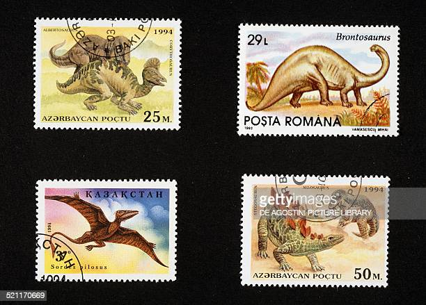 Top left and bottom right postage stamps depicting a Albertosaurus and Corythosaurus and Stegosaurus and Allosaurus Azerbaijan 1994 top left postage...
