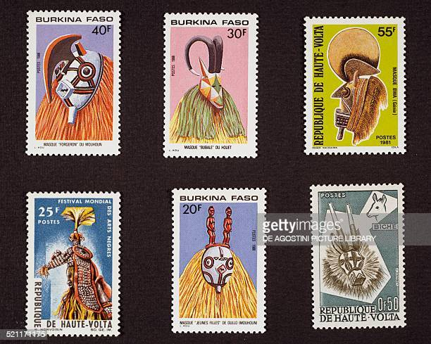 Top left and centre and bottom centre series of postage stamps from Burkina Faso honouring Traditional masks depicting a Blacksmith Bubalo and Young...