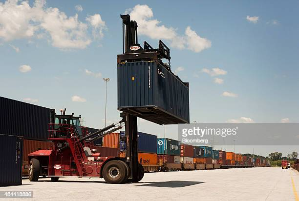 A top loader moves a shipping container to be placed onto a rail car at the Port of Savannah in Savannah Georgia US on Friday Aug 14 2015 The trade...