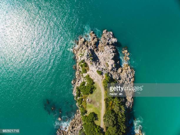 top looking down at moturiki island, new zealand. - mount maunganui stock photos and pictures