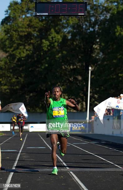 Top male finisher Ali Abdosh of Ethiopia crosses the finish line The Boston Athletic Association 2011 Half Marathon kicked off at 830 am in Franklin...