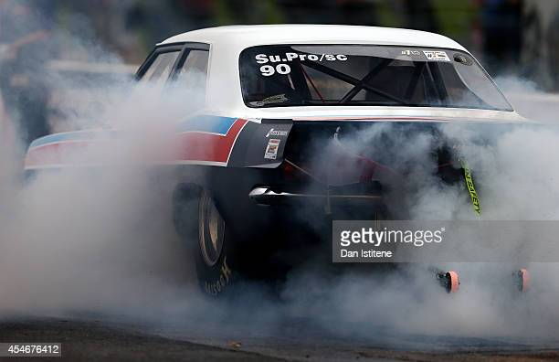 Top Methanol Dragster begins its burnout before a qualifying run for the European Drag Racing Championships at Santa Pod Raceway on September 5 2014...