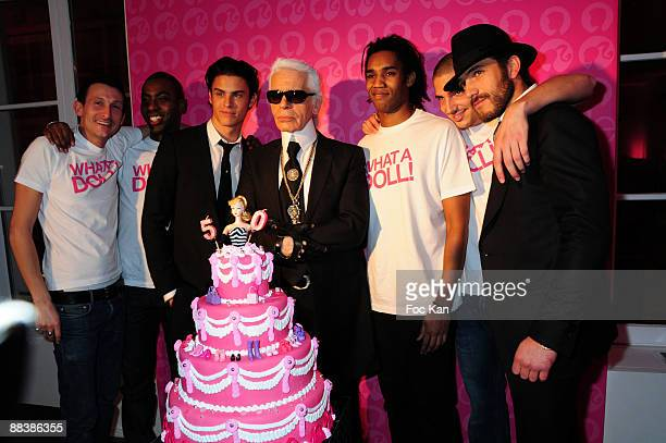 Top Model Baptiste Giabiconi Fashion Designer Karl Lagerfeld his Secretary Model Sebastien Jondeau and Waiters in White TeeShirts attend the Barbie...