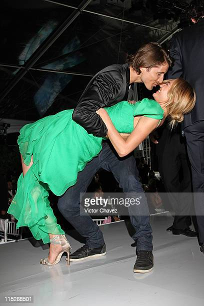 Top Model Candice Swanepoel and her boyfriend Hermann Nicoli dance on the stage during the Gala Moda Nextel Mexico City 2011 party at the Plaza de...