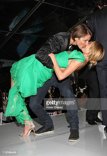 Top Model Candice Swanepoel and her boyfriend Hermann Nicoli kissing and dancing on the stage during the Gala Moda Nextel Mexico City 2011 party at...