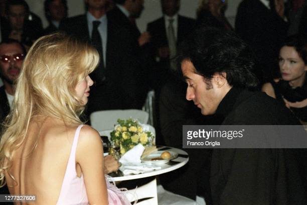 Top model Claudia Schiffer and David Copperfield attend a party for the inauguration of three new Valentino's boutiques on September 15, 1995 in...