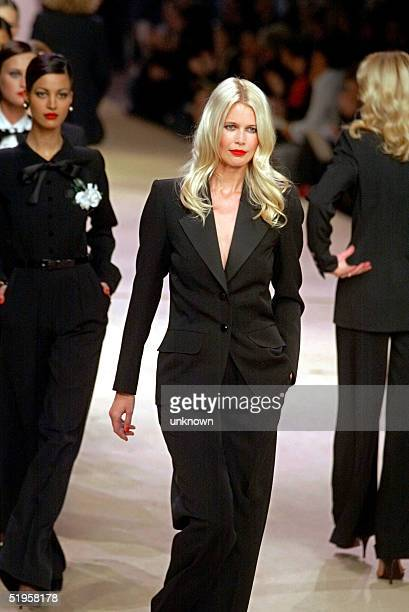 Top model Claudia Schiffer dressed with the famous Yves Saint Laurent tuxedo walks down the catwalk, 22 January 2002, during the retrospective part...