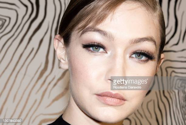 Top Model Gigi Hadid, make up detail is seen backstage at the Versace fashion show on February 21, 2020 in Milan, Italy.