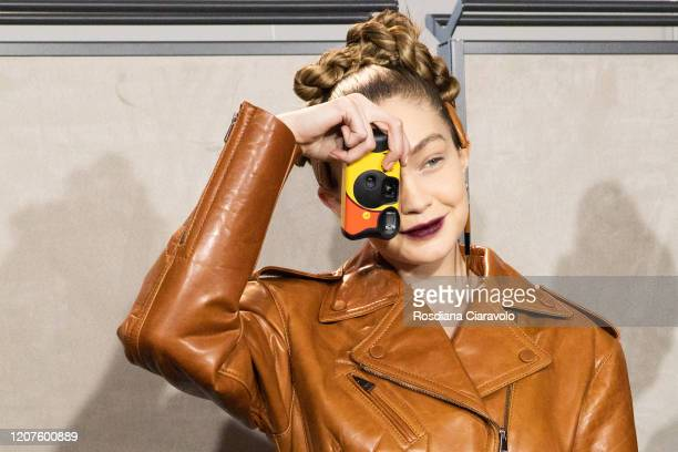 Top model Gigi Hadid with her single-use camera is seen backstage at the Fendi fashion show on February 20, 2020 in Milan, Italy.