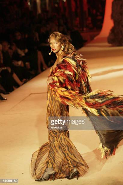 Top model Katoucha presents a creation for French designer Yves Saint Laurent 22 January 2002 during the retrospective part of Saint Laurent's last...