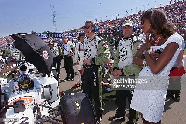 Top model Naomi Campbell watches at Canadian BarHonda driver Jacques Villeneuve on the starting grid of the Hungaroring racetrack before the start of...