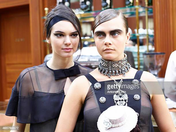 Top models Cara Delevingne and Kendall Jenner poses prior the Chanel show as part of the Paris Fashion Week Womenswear Fall/Winter 2015/2016 on March...
