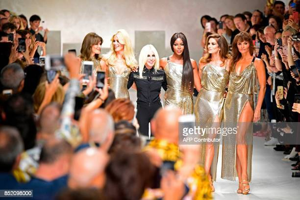 Top models Carla Bruni Claudia Schiffer Italian designer Donatella Versace Naomi Campbell Cindy Crawford and Helena Christensen walk the runway with...