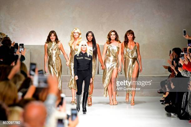Top models Carla Bruni Claudia Schiffer Naomi Campbell Cindy Crawford and Helena Christensen walk the runway with Italian designer Donatella Versace...
