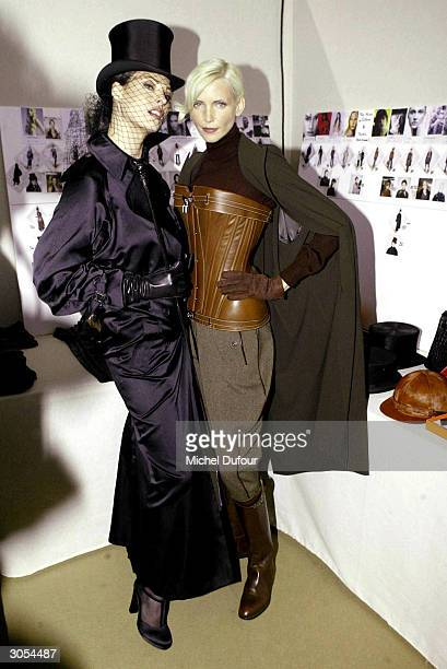 Top models Linda Evangelista and Nadja Auermann pose backstage after the Hermes readytowear Fall/Winter collection 20042005 fashion show on March 6...