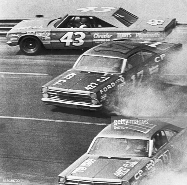 Top NASCAR driver Richard Petty hits the wall on the 4th turn here today midway in the National 500 Stock Car Race as Dave Pearson and Mario Andretti...