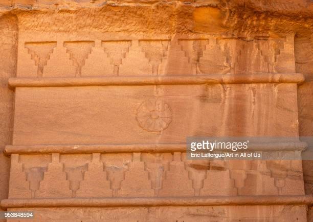 Top of a nabataean tomb in madain saleh archaeologic site, Al Madinah Province, Al-Ula, Saudi Arabia on January 25, 2010 in Al-ula, Saudi Arabia.