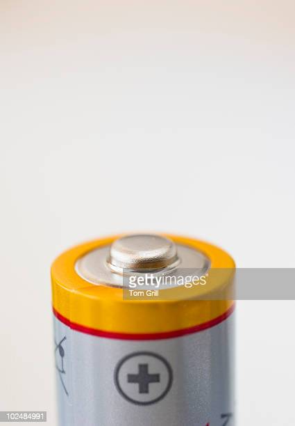 Top of AA battery