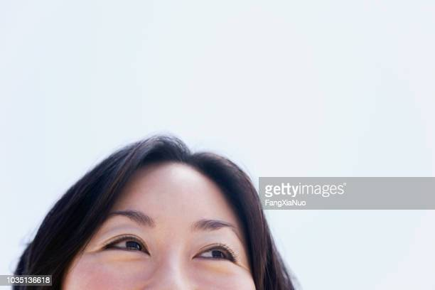 top of asian woman's face - high section stock pictures, royalty-free photos & images