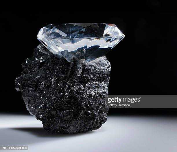 Top of large diamond sticking out of piece of coal
