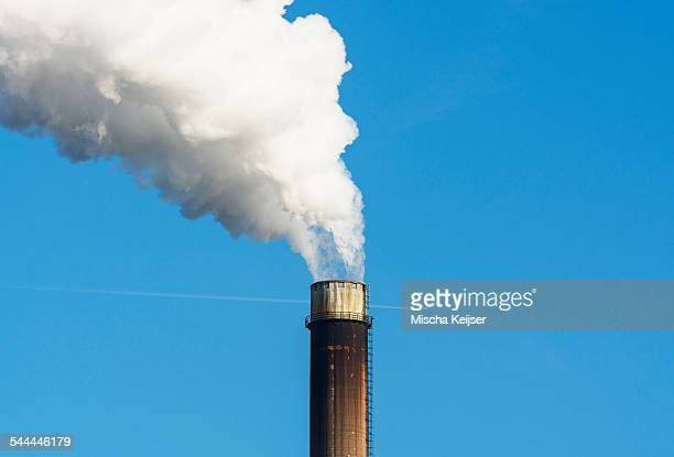 Top of smoke stack with blue sky