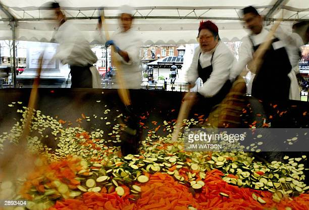 Top oriental TV chef Nancy Lam and other chefs mix vegetables in a giant wok in the middle of Liecester Square in London as she attempt to set the...