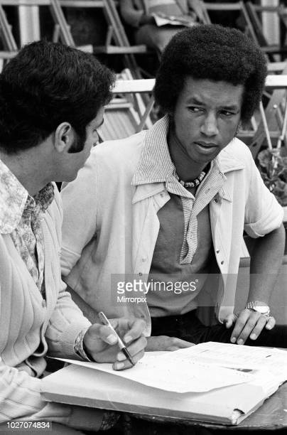 Top players at the Queen's Club Tournament at Queen's Club, Kensington. Arthur Ashe discusses the boycott with Paola Angeli . 21st June 1973.