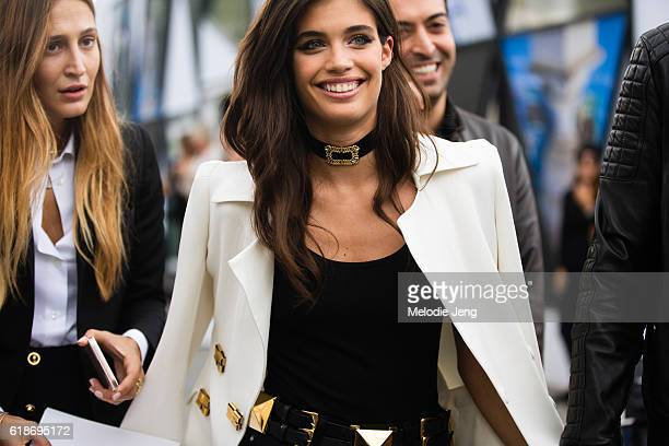 Top Portuguese model Sara Sampaio wears a white Ermanno Scervino blazer and a Fallon jewelry choker after the Elie Saab show at the Tuileries on...