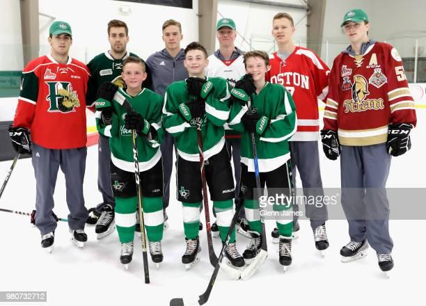 Top prosects Evan Bouchard Rasmus Dahlin Noah Dobson Andrei Svechnikov Brady Tkachuk and Filip Zadina pose with young hockey players at the Top...