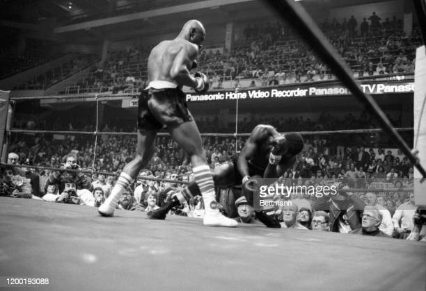 Top ranked middleweight contender Marvin Hagler sends Sugar Ray Seales to the canvas for the third time winning the fight 80 seconds into the 1st...
