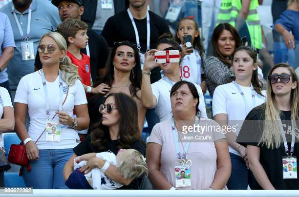 Top right Nicky Pike, wife of Ashley Young of England, Annabel Peyton, fiancee of Jack Butland, Annie Kilner, girlfriend of Kyle Walker, Rebekah...