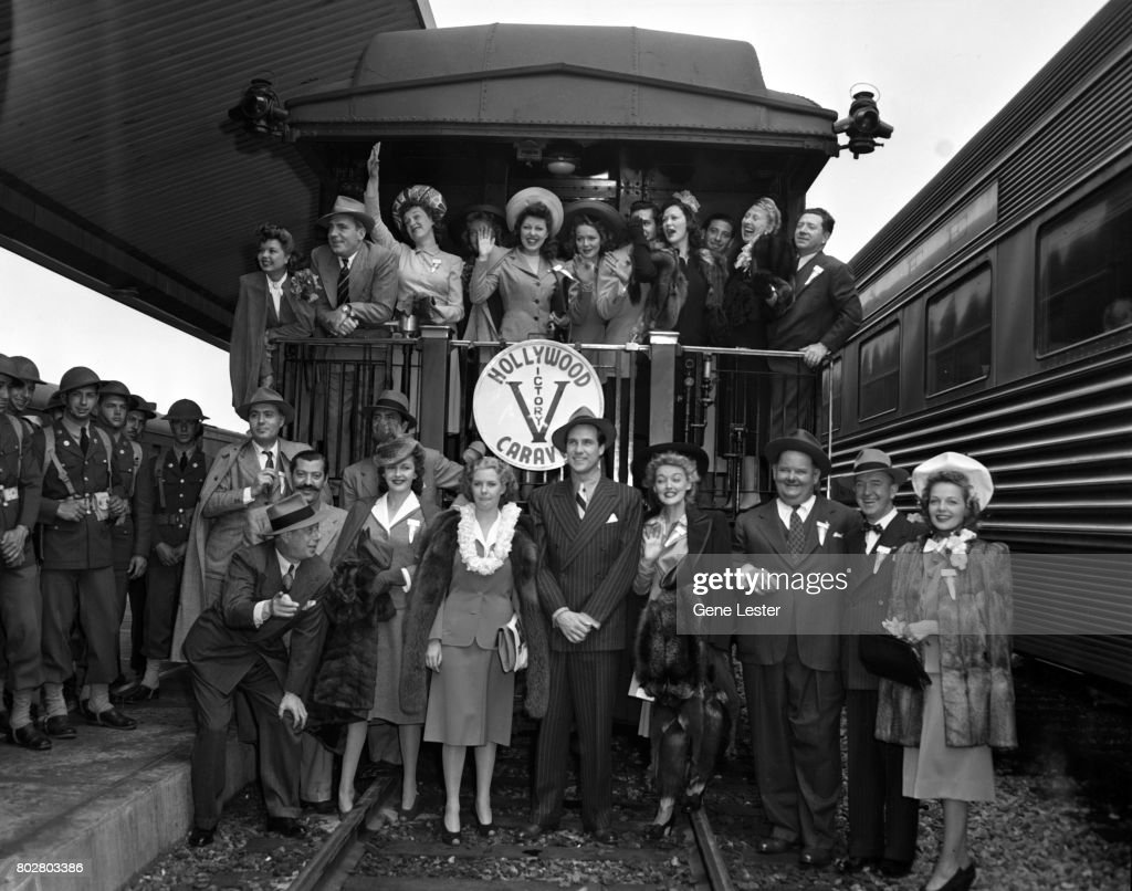 Frances Langford;Pat O'Brien;Rise Stevens;Faye McKenzie;Arlene Whelan;Desi Arnaz;Eleanor Powell;Charlotte Greenwood;Frank McHugh -- Bottom: Charles Boyer;Jerry Colonna;Bert Lahr;Frances Gifford;Marie McDonald;Ray Middleton;Karin Booth;Oliver Hardy;Stan Laurel;Elyse Knox at the LA train station aka Union Station as part of the Hollywood Victory Caravan which was a group of stars who toured 13 US cities to raise funds for Army and Navy relief during WW2 in March 1942.