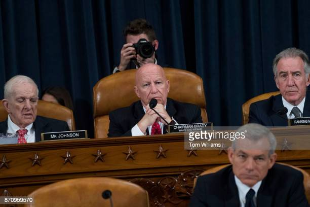Top row from left Rep Sam Johnson RTexas Chairman Kevin Brady RTexas and Rep Richard Neal DMass ranking member conduct a House Ways and Means...