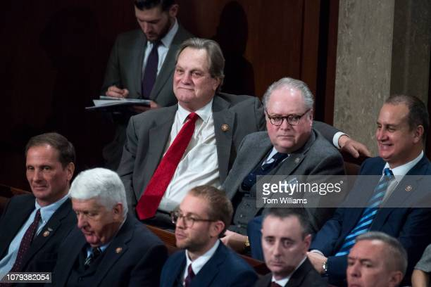 Top row from left Reps Mike Simpson RIdaho George Holding RNC and Mario DiazBalart RFla are seen in the Capitol's House chamber before members were...