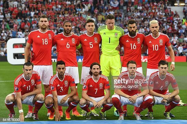 Wales' forward Sam Vokes Wales' defender Ashley Williams Wales' defender James Chester Wales' goalkeeper Wayne Hennessey Wales' midfielder Joe Ledley...