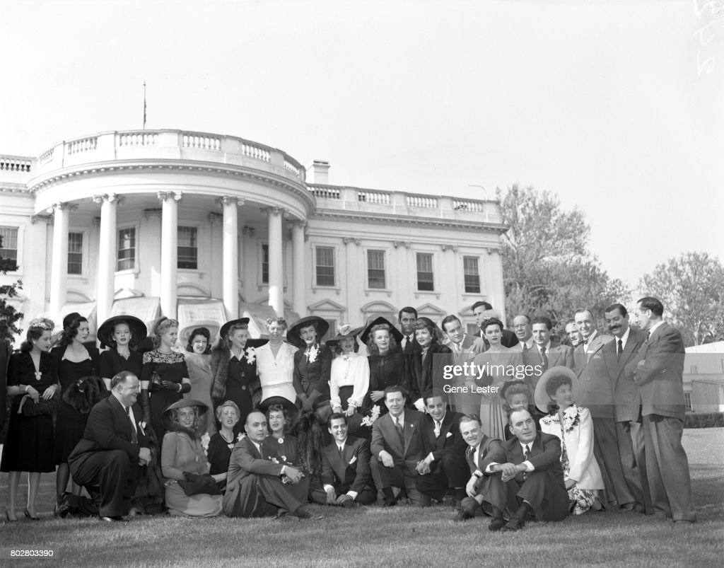 Jean Hersholt;Eleanor Powell;Arlene Whelan;Marie McDonald;Paye McKenzie;Karin Booth;Eleanor Roosevelt; Frances Gifford;Frances Longford;Elyse Knox;Cary Grant;Claudette Colbert;Bob Hope; Ray Middleton;Joan Bennett;Bert Lahr;Stan Laurel;Jerry Colonna;Groucho Marx and seated: Oliver Hardy;Joan Blondell;Charlotte Greenwood;Charles Boyer;Rise Stevens;Desi Arnaz;Frank McHugh;James Cagney;Pat O'Brien at the White House as part of the Hollywood Victory Caravan which was a group of stars who toured 13 US cities to raise funds for Army and Navy relief during WW2 in March 1942.