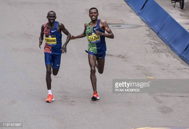 Top runners Lawrence Cheronoand Lelisa Desisa fight for the Men's Elite win in the last few hundred feet before the finish line at the 123rd Boston...